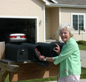 Elderly lady at mailbox with Wrist Monitor. MediGuardUAS, Omaha, NE