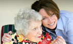 Personal assistant hugging elderly woman. MediGuardUSA, Omaha, NE