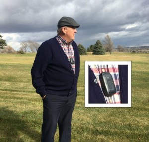 Man standing in a field wearing a mobile medical alert pendant. A small pendant worn around the neck, is our eMobile emergency medical alert pendant. If you fall or with a push of a button, it can call for help anywhere there is a cellular signal.